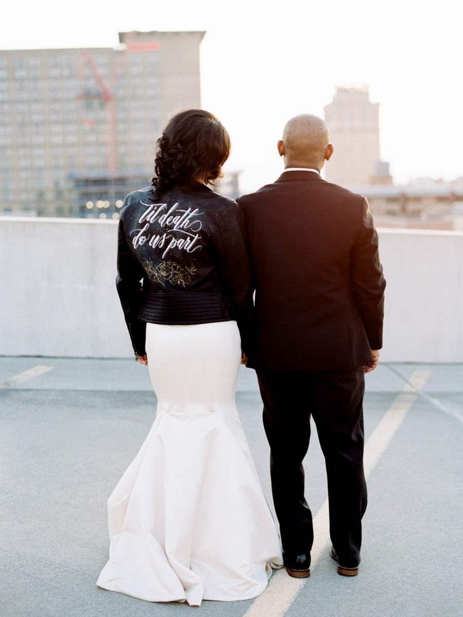 bride in a leather jacket with words