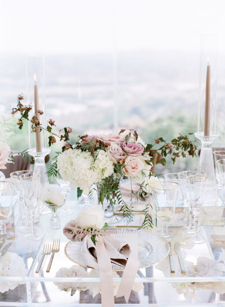 The tables were glass ones, the candles and decor was very neutral and the centerpieces were of chic pink, blush and white flowers