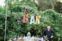 10 The wedding bar was done with a vintage dresser and marquee letters