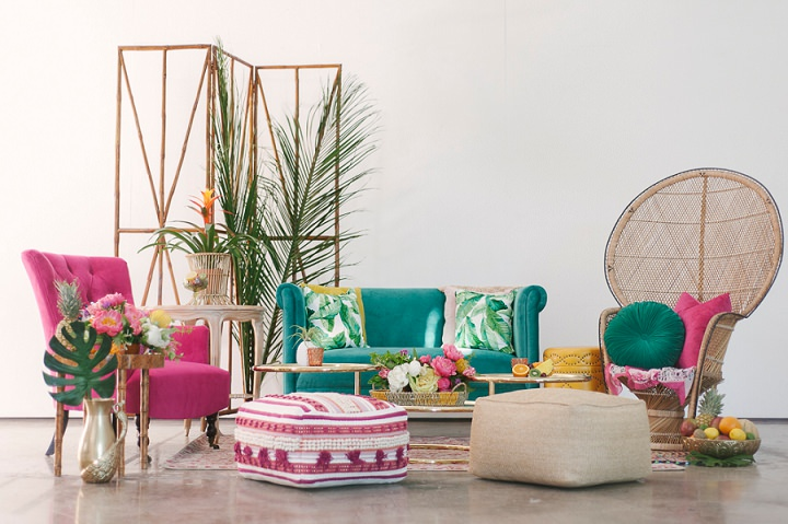 The wedding lounge was a colorful one in turquoise and pink plus tropical leaf prints and real leaves