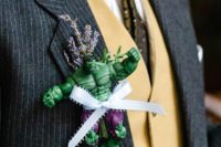 10 a Hulk boutonniere with lavender, greenery and a ribbon bow raises this groom's outfit to a new level