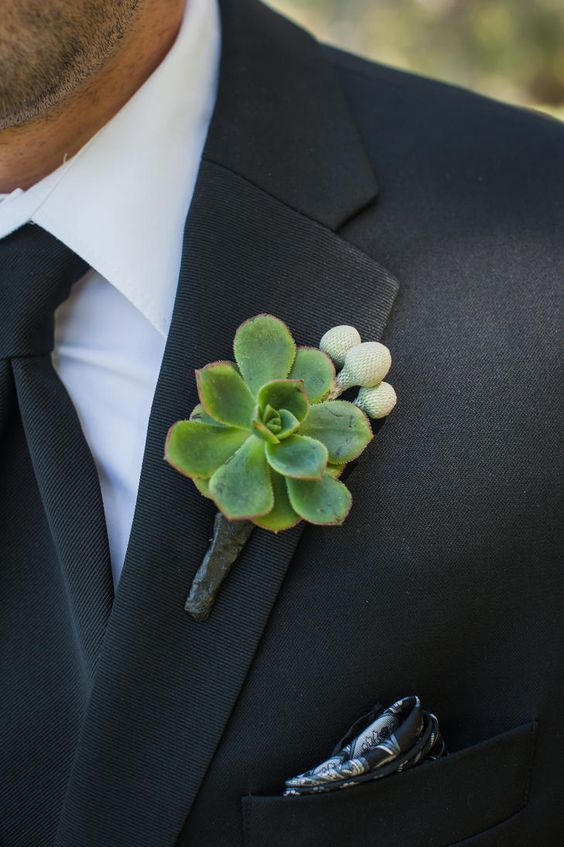 a chic succulent and berries boutonniere to spruce up a classic monochromatic groom's look