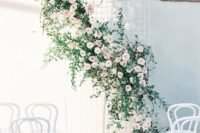 10 white wire mesh with a creative flower and greenery decoration on it, blush roses create an airy feeling