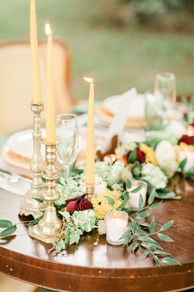Candles and fresh greenery enlivened the setting