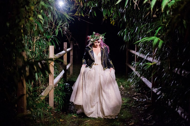 The bride covered up with a black leather jacket at night