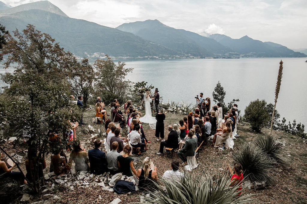 The ceremony took place on the shore of Lake Como, which was decorated with white blooms and greenery