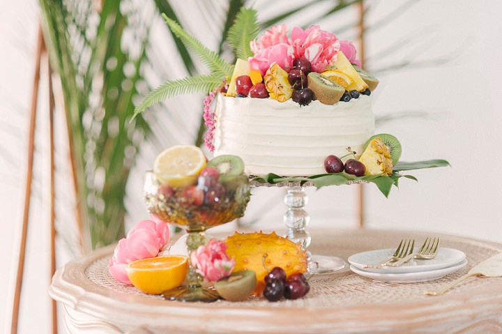 The wedding cake was a buttercream one topped with blooms and fresh fruits plus greenery