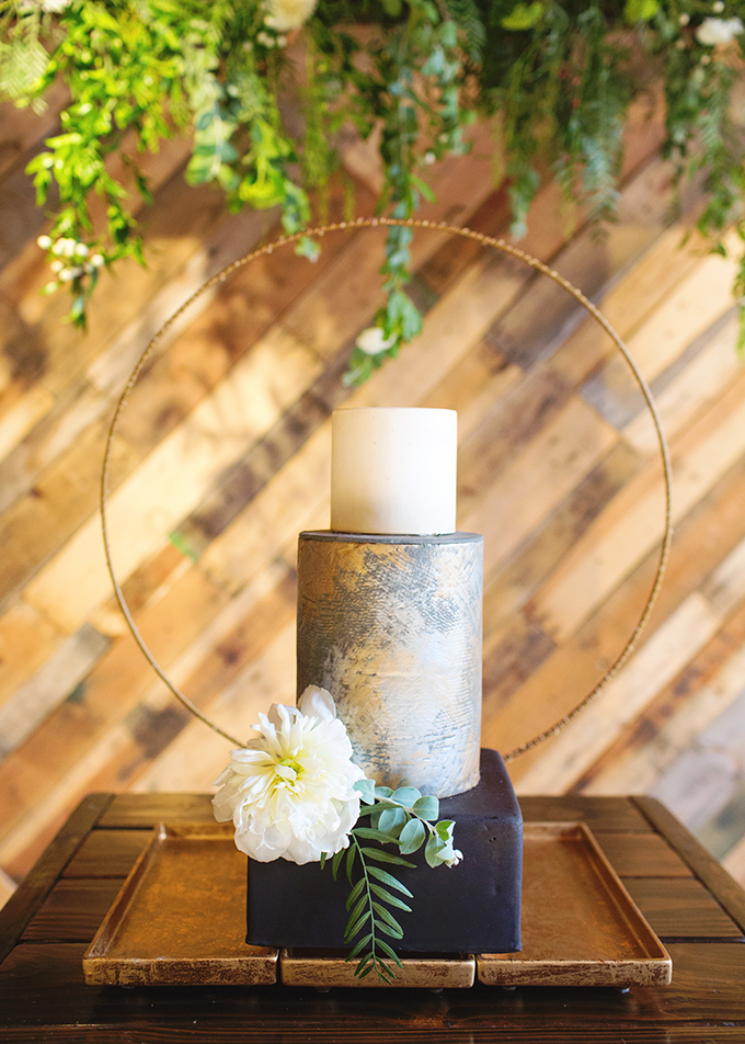 The wedding cake was a modern one, with metallic leaf and a large fresh bloom
