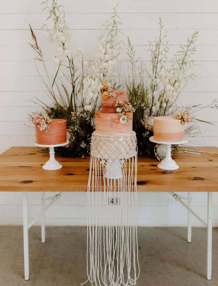 The wedding cakes were done in rust, with an ombre effect, blooms and macrame for decor