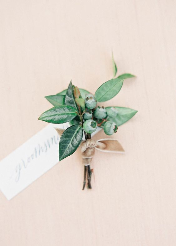 a foliage boutonniere with berries is a chic and catchy idea that doesn't include any blooms