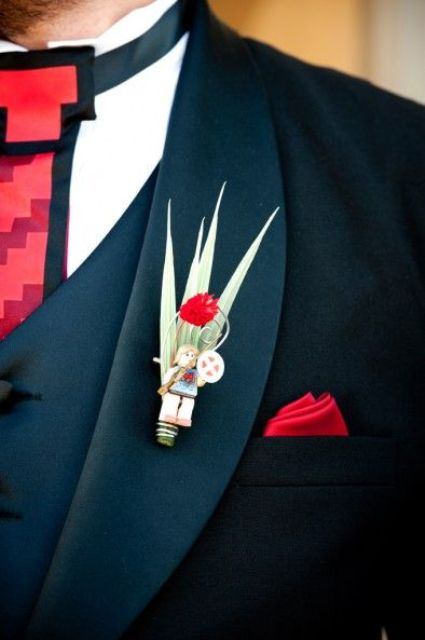 a nerdy boutonniere dedicated to Super Mario game, with foliage and a small LEGO piece
