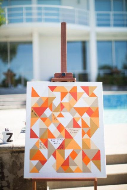 an ultra-modern bright geometric guest book idea to fill each piece on the artwork