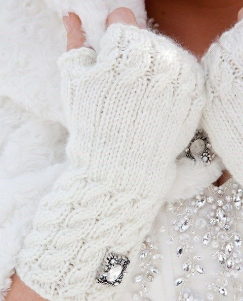 gorgeous white cable knit fingerless mittens decorated with heirloom brooches are a refiend accessory