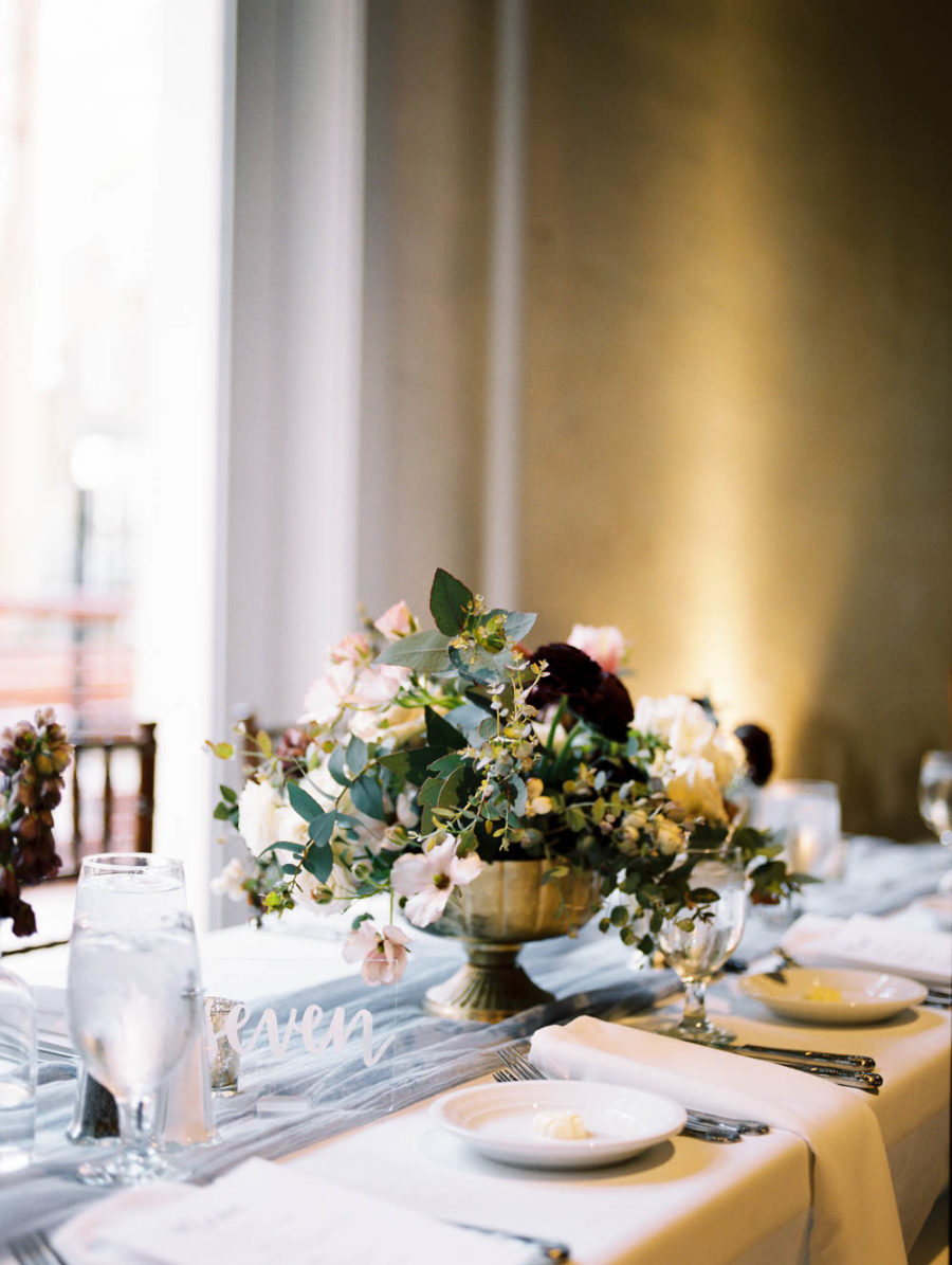 The wedding tablescapes were done with airy runners and lush yet nonchalant florals