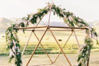 12 a geometric altar decorated with greenery and pampas grass is amazing for a boho chic or mid-century wedding