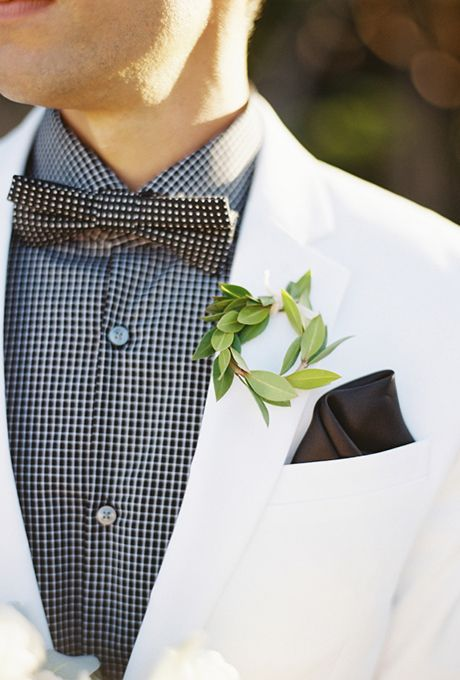 a greenery wreath boutonniere is a fresh touch to the bright and chic groom's look