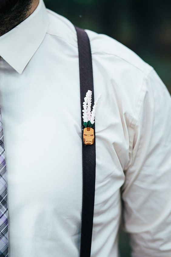 a tiny geeky Iron Man boutonniere with fake blooms attached to the suspenders for a touch of whimsy