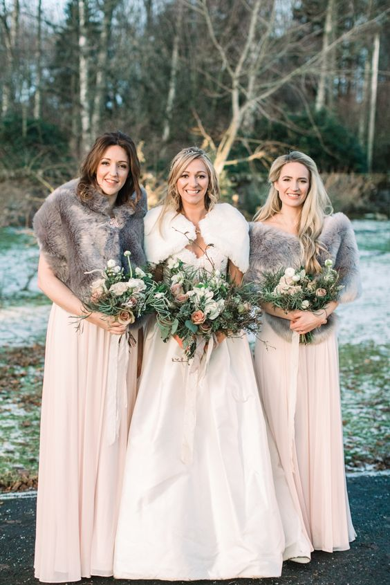 cover up your bridesmaids in faux fur stoles, too, to keep them warm and comfortable outdoors