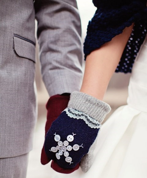 navy mittens decorated with lace and button snowflakes to match a navy coverup and stand out in the snow
