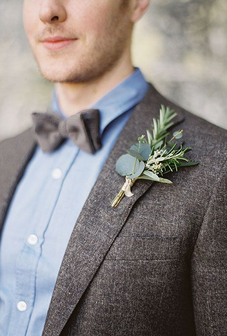 a boutonniere of various types of greenery - eucalyptus and rosemary and a simpel wrap