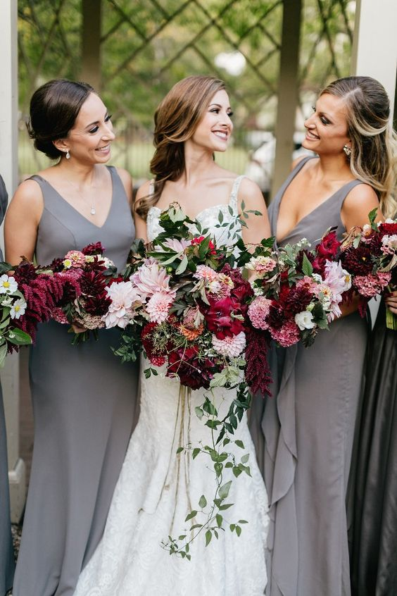plain sheath bridesmaid dresses with deep neckline and thick straps and cascading pink and burgundy bouquets