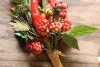 13 raspberries, peppers and llex for a bright summer to fall boutonniere and a touch of nature