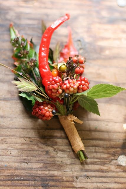 raspberries, peppers and llex for a bright summer to fall boutonniere and a touch of nature