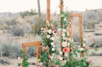 13 rustic wooden frames decorated with lush flowers and greenery for a desert space or a rustic feel at your backyard wedding