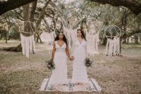 14 a boho chic ceremony space with white yarn dreamcatchers and a boho rug for an outdoor boho ceremony