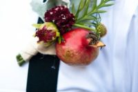 14 a pomegranate and bloom boutonniere with pale greenery for a fall rustic or farm to table wedding