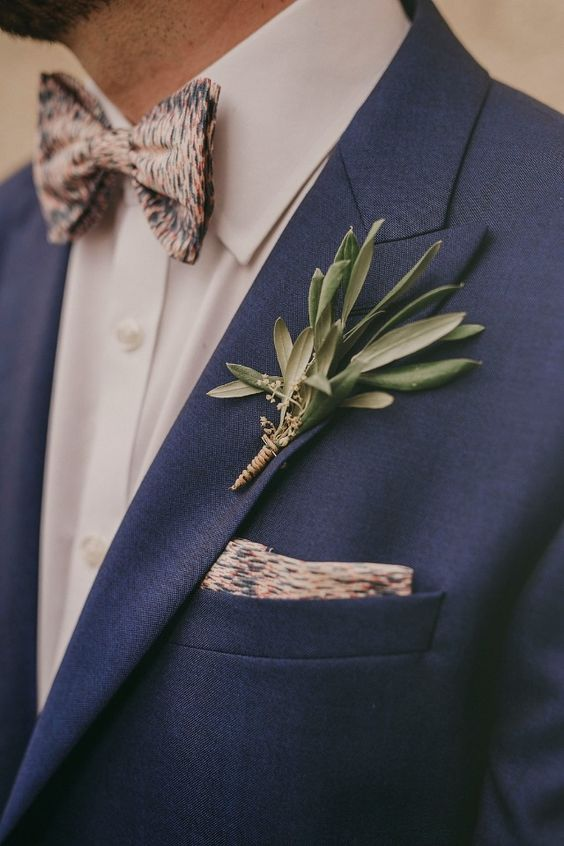 a simple eucalyptus boutonniere with a twine wrap is ideal for an Italian or Tuscany wedding