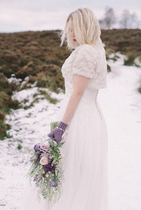 purple knit mittens that match the tender lilac and blush wedding bouquet and add color to the look