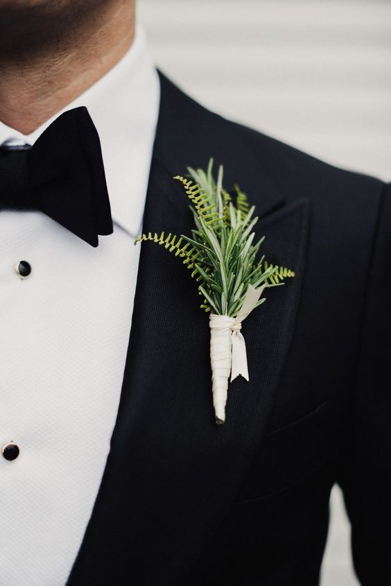 a textural greenery groom's boutonniere with a white wrap for polishing the super elegant look