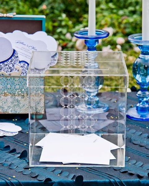 an acrylic box with guest cards is all you need to pull off a modern wedding look and decor