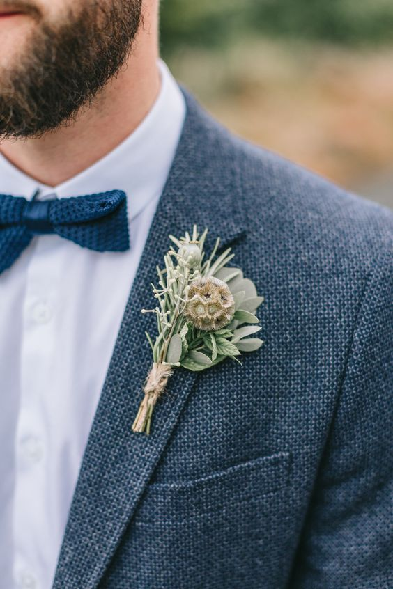 a boutonniere of rosemary, seeded herbs, greenery and a twine wrap for a textural and rustic feel