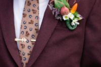 16 a veggie and flower boutonniere will make your look whimsy and is great for farm to table weddings