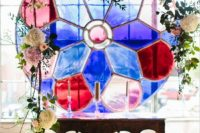 17 a colorful glass mosaic decorated with blooms is a stunning eye-catchy idea for adding a unique touch to your decor