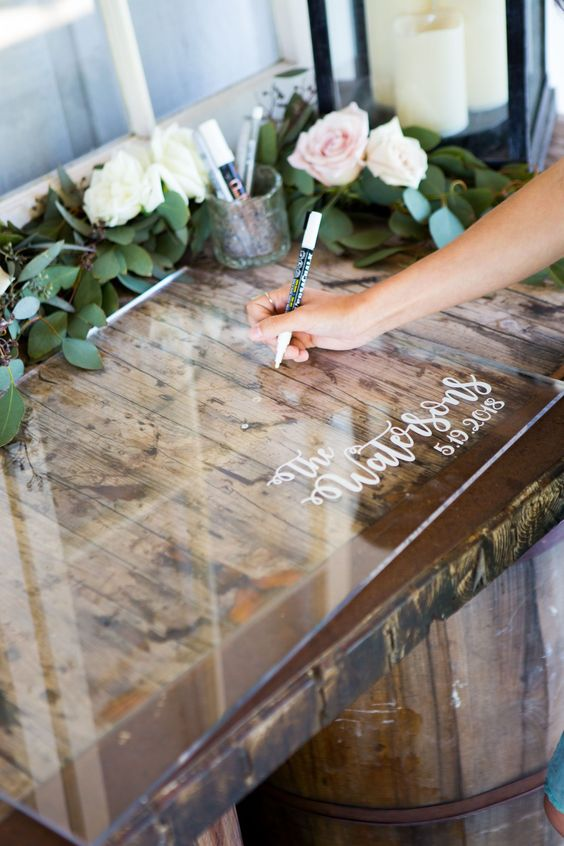 a clear guest book sign and some chalk pens are great for a modern and many other weddings and looks original
