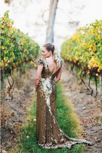 a gold sequin wedding dress with a cutout back, cap sleeves and a small train will make you stand out