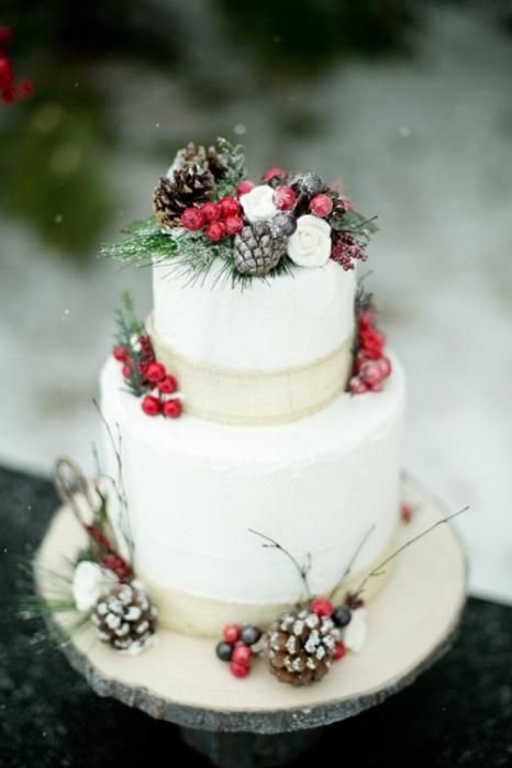 fake evergreens, berries, blooms and pinecones are great to accent a Christmas wedding cake
