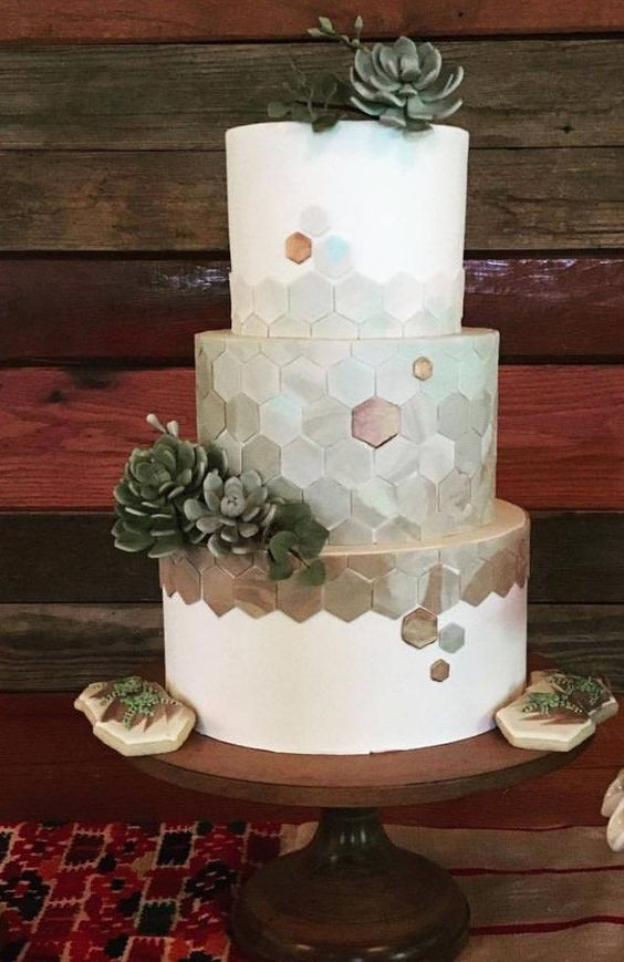 a chic modern geometric wedding cake with marble hexagons and sugar succulents is a fashionable idea to rock