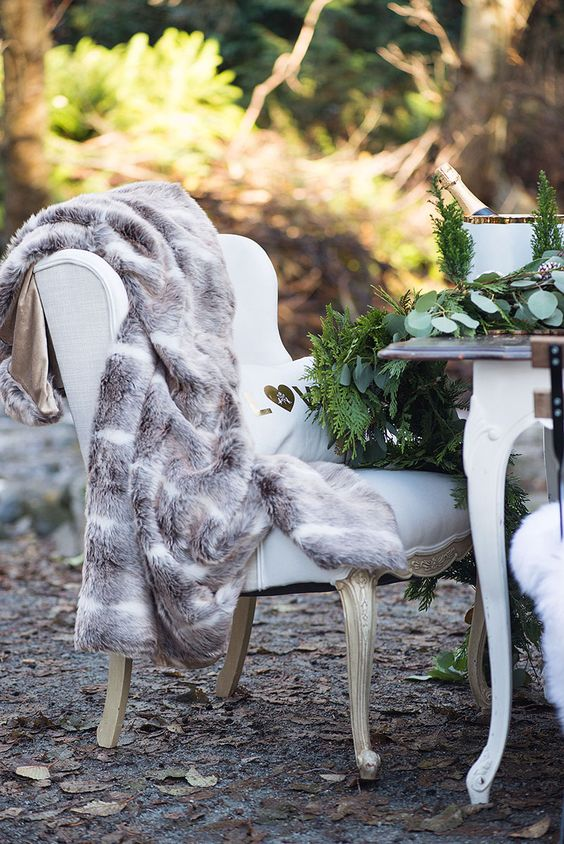 a refined vintage chair covered up with faux fur for comfortable sitting and shooting outside is a good idea for winter