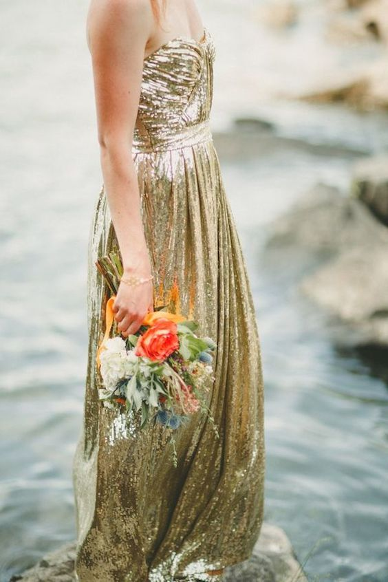 a strapless gold sequin A line wedding dress is a timeless and sparkly idea to rock