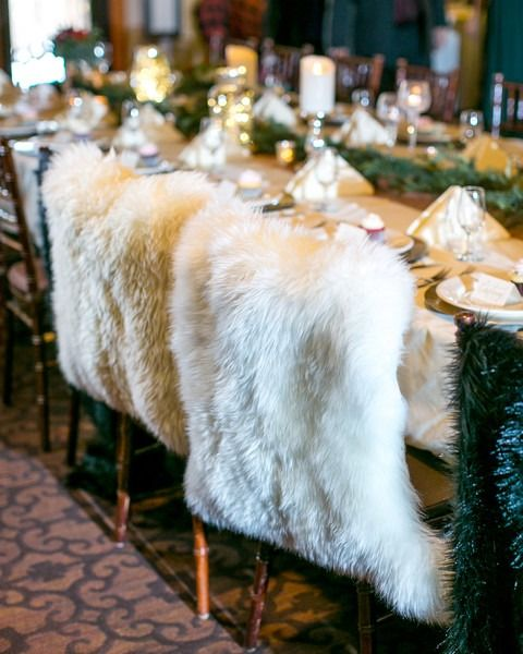 chic white faux fur wedding chair covers will make your chairs stand out and you'll feel cozier sitting on them