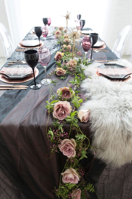 dark purple linens, a pink rose table runner and a touch of faux fur for a sophisticated wedding table setting
