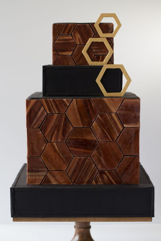 a modern geometric wood-inspired wedding cake with a hexagon pattern and matching toppers looks wow