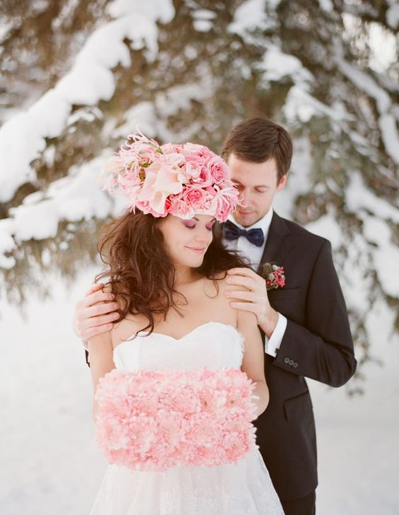 an oversized pink floral crown and pink smokeys and a faux flower hand warmer to stand out in the snow