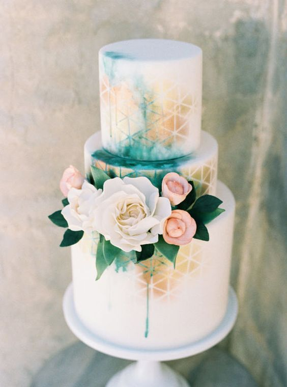 a neutral wedding cake spruced up with bold watercolor in turquoise and gold touches plus pink and white blooms