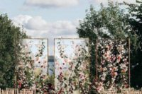 25 framed acrylic screens decorated with colorful blooms and greenery for a bright and luxurious wedding backdrop