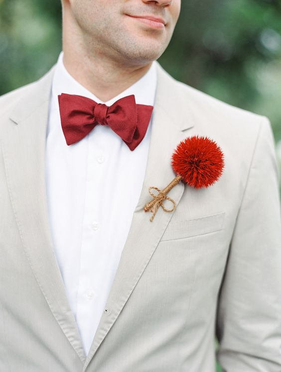 a unique red thistle and twine groom's boutonniere to match his bow tie and add color